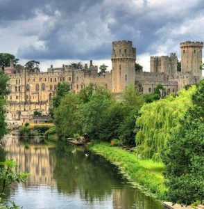 The medieval Warwick Castle on the banks of the River Avon, Warwick, England.